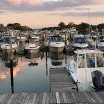 sunset over lighthouse marina dock